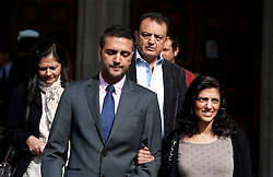© Licensed to London News Pictures. 30/03/2012. London, UK.  Family of Anni Dewani L to R Nilam Mindocha (Mother) Anish Hindocha (Brother) Vinod Hindocha (Father) and Ami Denborg (Sister) The High Court on March 30, 2012 where a judge temporarily halted British businessman Shrien Dewani's extradition to South Africa on mental health grounds. Shrien Dewani, is accused of arranging the contract killing of wife Anni in Cape Town in November 2010. Photo credit : Ben Cawthra/LNP