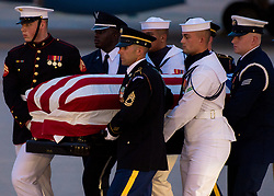 JOINT BASE ANDREWS, Md. (Aug. 30, 2018) A Joint Service Arrival Team carry the flag-draped casket of Sen. John S. McCain III at Joint Base Andrews, Md., Aug. 30, 2018. The former senator's remains are en route to lie in state in the U.S. Capitol Rotunda. (U.S. Air Force photo by Airman 1st Class Jalene Brooks/Released) 180830-F-DO528-0116