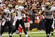 New Orleans Saints WR Lance Mooore (16) celebrates with teammate Pierre Thomas (23) after scoring a touchdown against the Falcons. New Orlenas Sainst (k) kicker Garrett Hartley (5) kicks a field  goal to tie the game and seend it to OT against the Atlanta Falcons, then misses a field goal in OT and teh Falcons went on to win 27-24.The Super Bowl Champions New Orleans Saints play the Atlanta Falcons Sunday Sept 26, 2010 in New Orleans at the Super Dome in Louisiana.  The Saints and Falcons are tied at half time and went into overtime tied 24-24. Hartley missed a kick to win in overtime., the Atlanta Falcons went on to win on OT with a field goal 27-24. PHOTO©SuziAltman.com