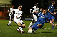 Photo: Rich Eaton.<br /> <br /> Peterborough United v Swansea City. Johnstone's Paint Trophy. 31/10/2006. Chris Jones left of Swansea finds his shot blocked by Dean Holden of Boro