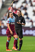 Abigail Bryne (Referee) awards a yellow card to Ceclilie Redisch Kvamme (West Ham)  during the FA Women's Super League match between West Ham United Women and Tottenham Hotspur Women at the London Stadium, London, England on 29 September 2019.
