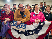 08 DECEMBER 2019 - CORALVILLE, IOWA: A man holds a Pete Buttigieg sign before a Buttigieg campaign event Sunday. Buttigieg, the mayor of South Bend, Indiana, is running to be the Democratic nominee for President in the 2020 election. Iowa traditionally holds the first presidential selection event of the 2020 election cycle. The Iowa Caucuses are on Feb. 3, 2020.   PHOTO BY JACK KURTZ
