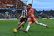Grimsby Town defender Luke Hendrie (27) and MK Dons midfielder Alex Gilbey (8) during the EFL Sky Bet League 2 match between Grimsby Town FC and Milton Keynes Dons at Blundell Park, Grimsby, United Kingdom on 26 January 2019.