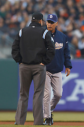 July 7, 2011; San Francisco, CA, USA;  San Diego Padres manager Bud Black (20) argues a call with MLB umpire Andy Fletcher (49)during the fourth inning against the San Francisco Giants at AT&T Park.