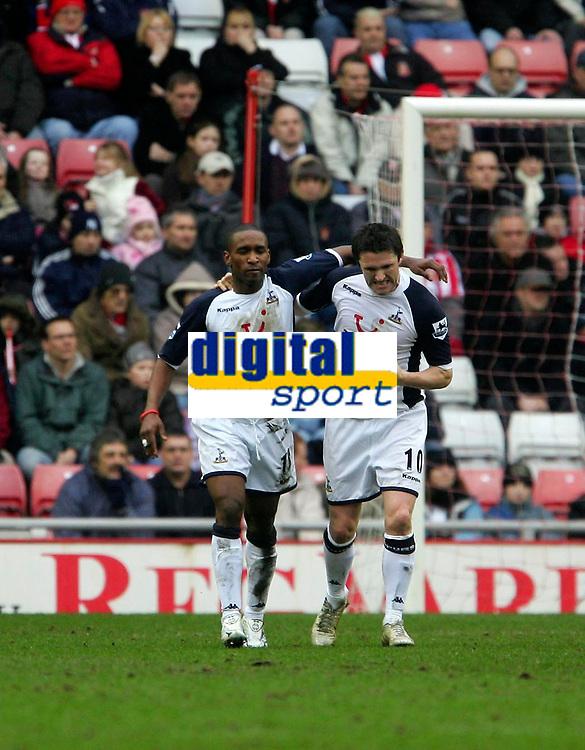 Photo: Andrew Unwin.<br /> Sunderland v Tottenham Hotspur. The Barclays Premiership. 12/02/2006.<br /> Tottenham's Robbie Keane (R) celebrates scoring his team's first goal with Jermaine Defore (L).