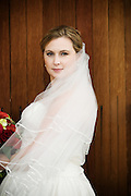 Bride with veil and flowers at Willamette Valley Vineyards