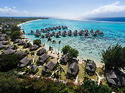Aerial photograph of the Sofitel Ia Ora Beach Resort & lagoon, Temae, Moorea, French Polynesia. Tahiti island is in the distance.