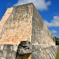 Great Ballcourt at Chichen Itza, Mexico<br /> Mayans loved their ball games for nearly three millenniums. It has several names including pitz, pok-a-tok, Mesoamerican ballgame or simply Maya ball. The Aztecs called it ōllamalizti. The sport was a blend of athletic endurance (games could last two weeks) with religious overtones and human sacrifice. Chichen Itza has 17 courts. This was the biggest with parallel walls measuring over 500 feet long. The Great Ballcourt is also the largest of more than 1,300 Mesoamerican ball courts uncovered in central Mexico, Belize, Guatemala and three more neighboring countries. It was constructed in 864 AD.