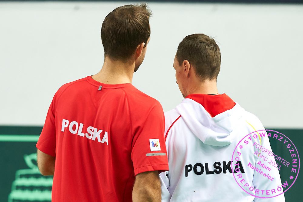 (L) trainer assistant Aleksander Charpantidis and (R) Radoslaw Szymanik - captain national team during first day the Davies Cup / Group I Europe / Africa 1st round tennis match between Poland and Lithuania at Orlen Arena on March 6, 2015 in Plock, Poland<br /> Poland, Plock, March 6, 2015<br /> <br /> Picture also available in RAW (NEF) or TIFF format on special request.<br /> <br /> For editorial use only. Any commercial or promotional use requires permission.<br /> <br /> Mandatory credit:<br /> Photo by &copy; Adam Nurkiewicz / Mediasport