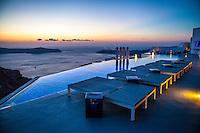 Infinity pool at sunset at Grace Santorini Hotel, Imerovigli, Santorini, Greece