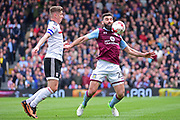 Aston Villa midfielder Mile Jedinak (25) controls the ball from Fulham midfielder Tom Cairney (10) during the EFL Sky Bet Championship match between Fulham and Aston Villa at Craven Cottage, London, England on 17 April 2017. Photo by Jon Bromley.