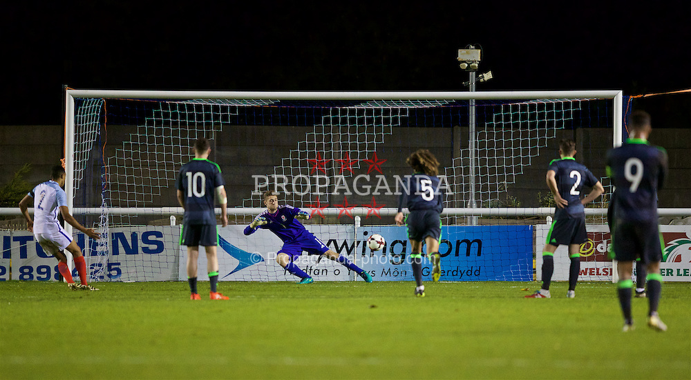BANGOR, WALES - Saturday, November 12, 2016: Wales' goalkeeper Fergal Hale-Brown is beaten as England's Trent Alexander-Arnold scores his side's equalising second goal from the penalty spot to level the score at 2-2 during the UEFA European Under-19 Championship Qualifying Round Group 6 match at the Nantporth Stadium. (Pic by Gavin Trafford/Propaganda)
