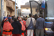 Crowd trying to get on bus  Ollantaytambo, Peru