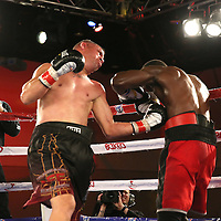 Eric Pinero (L) throws a left uppercut to the body of Inka Laley during a Telemundo Boxeo boxing match at the A La Carte Pavilion on Friday, March 13, 2015 in Tampa, Florida.  Laley won the bout. (AP Photo/Alex Menendez)