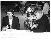 Mick Jagger, Madonna &amp; Tony Curtis at the Vanity Fair Oscar Night Party.  Mortons. Los Angeles.  24 March 1997<br />