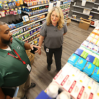 Anthony Morgan and Brooke Massey, team members at Toyota Motor Manufacturing Mississippi, look through the items in stock at the onsite pharmacy and Wal-Mart store that will soon open at the plant in Blue Springs.