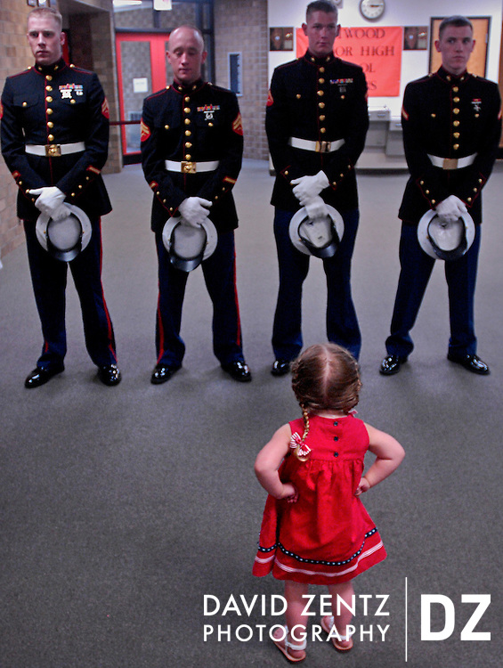 """""""Those aren't daddy,"""" says Kyra Coyle-Desilets, 3, as she sizes up her late father's fellow Marines at a public viewing of his body in Elmwood, Ill. Lance Cpl. Benjamin Desilets, a single father, died in combat in the Anbar province of Iraq at the age of 21."""