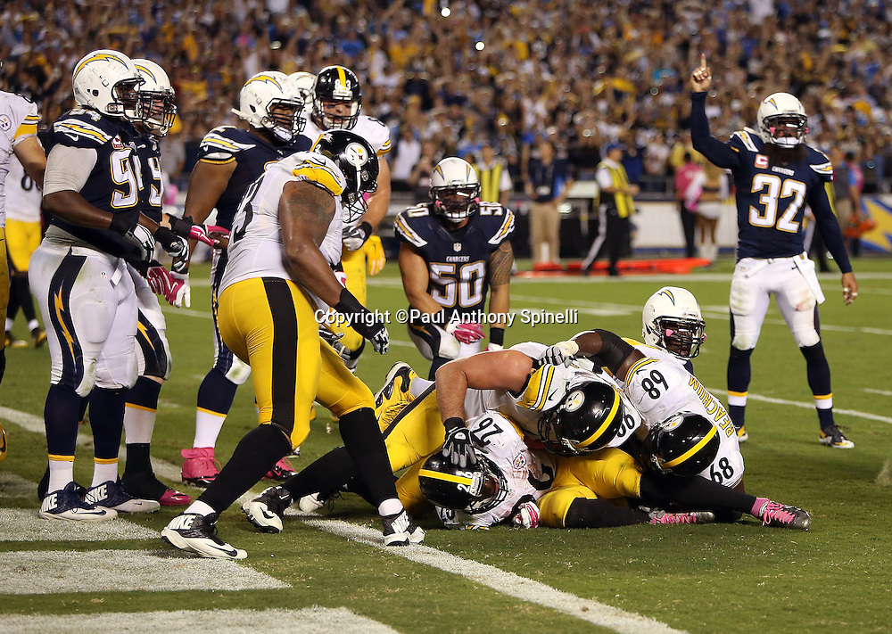 Pittsburgh Steelers running back Le'Veon Bell (26) gets mobbed by Pittsburgh Steelers guard David DeCastro (66) and Pittsburgh Steelers tackle Kelvin Beachum (68) after Bell runs for the game winning touchdown during the 2015 NFL week 5 regular season football game against the San Diego Chargers on Monday, Oct. 12, 2015 in San Diego. The Steelers won the game 24-20. (©Paul Anthony Spinelli)