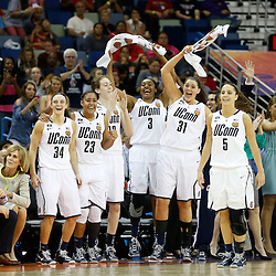 Apr 9, 2013; New Orleans, LA, USA; Connecticut Huskies players celebrate against the Louisville Cardinals during the second half of the championship game in the 2013 NCAA womens Final Four at the New Orleans Arena. Mandatory Credit: Derick E. Hingle-USA TODAY Sports