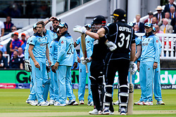 Chris Woakes of England looks on as Henry Nicholls of New Zealand reviews an LBW - Mandatory by-line: Robbie Stephenson/JMP - 14/07/2019 - CRICKET - Lords - London, England - England v New Zealand - ICC Cricket World Cup 2019 - Final