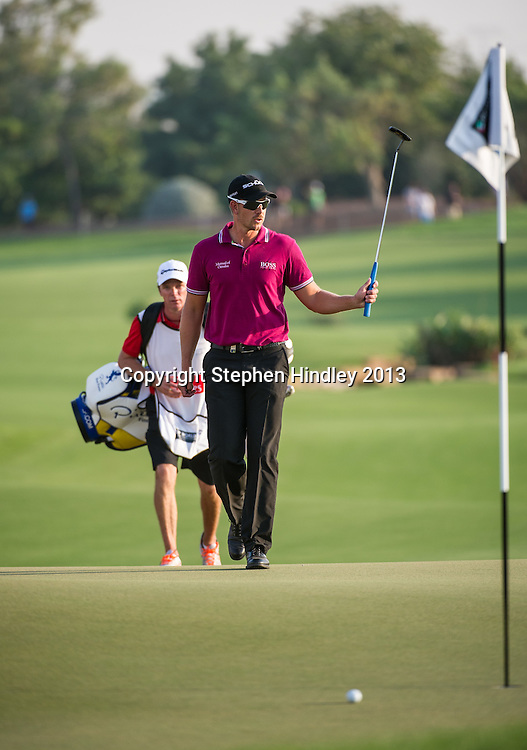 Henrik Stenson of Sweden at the end of 18 holes of the second round of the DP World Tour Championship leads the feild at  -12, held at the Jumeirah Golf Estates in Dubai, United Arab Emirates, on Friday, November 15, 2013.  Photo by: Stephen Hindley/SPORTDXB
