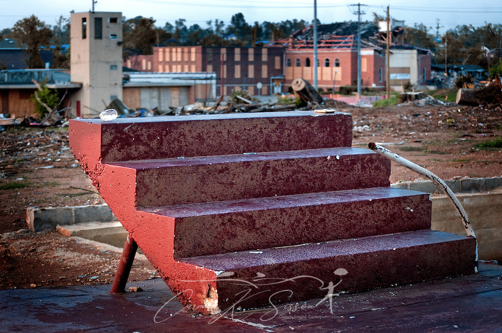 Porch steps -- all that remains of a home after the April 27 tornado -- stand in front of a heavily damaged church in Alberta City July 26, 2011 in Tuscaloosa, Ala. More than 43 people died, and more than 7,000 buildings were destroyed, when the F-5 tornado roared through the area. (Photo by Carmen K. Sisson/Cloudybright)