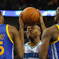 January 5, 2011; New Orleans, LA, USA; New Orleans Hornets point guard Jarrett Jack (2) collides with Golden State Warriors small forward Reggie Williams (55) and power forward Ekpe Udoh (20) during the first half at the New Orleans Arena.   Mandatory Credit: Derick E. Hingle