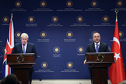 ANKARA, Sep. 27, 2016 (Xinhua) -- Turkish Foreign Minister Mevlut Cavusoglu (R) and visiting British Foreign Secretary Boris Johnson attend a press conference in Ankara, Turkey, on Sept. 27, 2016. Turkish Foreign Minister Mevlut Cavusoglu on Tuesday criticized the U.S. of not convincing Syrian Kurdish fighters to move to east of Euphrates River. (Xinhua/Mustafa Kaya) (zf) (Credit Image: © Mustafa Kaya/Xinhua via ZUMA Wire)