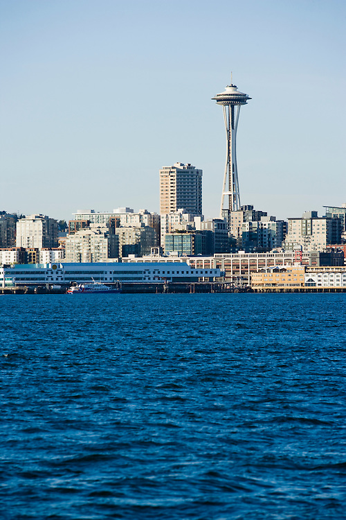 The Space Needle and surrounding buildings on the waterfront of downtown Seattle, WA USA