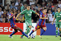 FOOTBALL - CHAMPIONS LEAGUE 2010/2011 - GROUP STAGE - GROUP D - FC BARCELONA v PANATHINAIKOS - 14/09/2010 - PHOTO JEAN MARIE HERVIO / DPPI - KOSTAS KATSOURANIS (PAN) / ERIC ABIDAL / LIONEL MESSI (FCB)