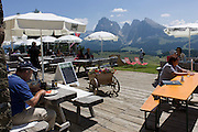Refuge hut terrace lunches on the Siusi plateau, above the South Tyrolean town of Ortisei-Sankt Ulrich in the Dolomites, Italy.