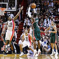 22 January 2012: Milwaukee Bucks shooting guard Stephen Jackson (5) takes a three points jumpshot over Miami Heat point guard Mario Chalmers (15) during the Milwaukee Bucks 91-82 victory over the Miami Heat at the AmericanAirlines Arena, Miami, Florida, USA.