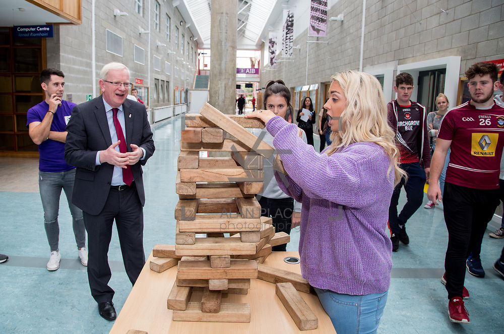 05.09. 2017.                             <br /> Limerick Institute of Technology welcomed its first year students onto Campus today 5th Sept 2017. <br /> Challenging the President of LIT, Prof. Vincent Cunnane to a game of Jenga were Marketing and Management Students, left to right, Chelsea McCarthy, Patrickswell and Courtney Grimmes, Weston. Picture: Alan Place