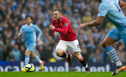 MANCHESTER, ENGLAND - Sunday, January 8, 2012: Manchester United's Wayne Rooney in action against Manchester City during the FA Cup 3rd Round match at the City of Manchester Stadium. (Pic by Vegard Grott/Propaganda)