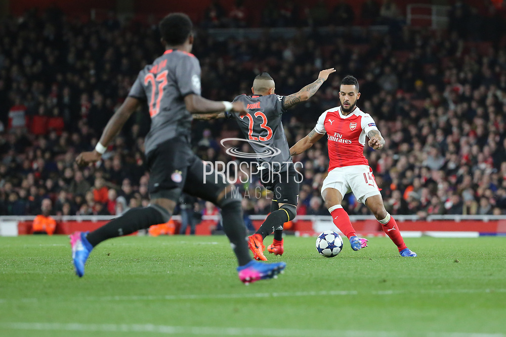 Bayern Munich midfielder Arturo Vidal (23) battles for possession with Arsenal attacker Theo Walcott (14) during the Champions League round of 16, game 2 match between Arsenal and Bayern Munich at the Emirates Stadium, London, England on 7 March 2017. Photo by Matthew Redman.