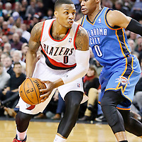 04 December 2013: Portland Trail Blazers point guard Damian Lillard (0) drives past Oklahoma City Thunder point guard Russell Westbrook (0) during the Portland Trail Blazers 111-104 victory over the Oklahoma City Thunder at the Moda Center, Portland, Oregon, USA.