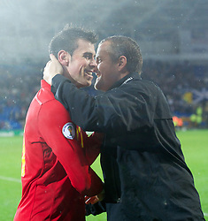 CARDIFF, WALES - Friday, October 12, 2012: Wales' Gareth Bale celebrates with goalkeeping coach Martyn Margetson after the 2-1 victory over Scotland during the Brazil 2014 FIFA World Cup Qualifying Group A match at the Cardiff City Stadium. (Pic by David Rawcliffe/Propaganda)