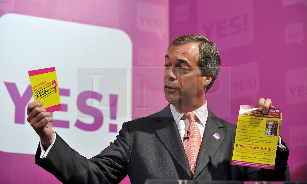 © licensed to London News Pictures. LONDON UK. 27/04/11. Nigel Farage holds up campaign leaflets for UKIP and the NO campaign. A News conference held today (27 April 2011) in Church House, London. The conference was introduced by Katie Ghose with Lib Dem President Tim Farron, Green Party Leader Caroline Lucas, UKIP leader Nigel Farage and  Labour's  Alan Johnson, supporting a Yes for the Alternative Vote. Photo credit should read Stephen Simpson/LNP