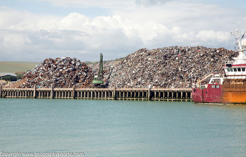 Scrap metal piled on quayside, Newhaven, East Sussex, England