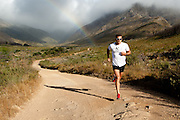 Dan Hugo on a training run in Jonkershoek, Stellenbosch. Multi-sport champion running through his scenic neighbourhood. Image by Greg Beadle, Jawbone eyewear by Oakley