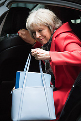 Downing Street, London, February 11th 2016. Home Secretary Theresa May steps out of her car as she attends the weekly cabinet meeting. <br /> &copy;Paul Davey<br /> FOR LICENCING CONTACT: Paul Davey +44 (0) 7966 016 296 paul@pauldaveycreative.co.uk