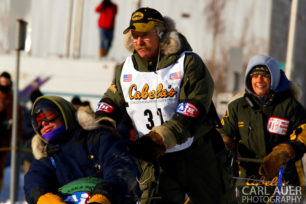 3/3/2007:  Anchorage Alaska -  Veteran Jeff King of Denali, AK head down the streets of Anchorage during the Ceremonial Start of the 35th Iditarod Sled Dog Race