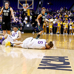 Mar 24, 2013; Baton Rouge, LA, USA; LSU Tigers guard Jeanne Kenney (5) lies on the floor after colliding with teammate guard Adrienne Webb (10) late in the second half of a game against the Green Bay Phoenix in the first round of the 2013 NCAA womens basketball tournament at the Pete Maravich Assembly Center.  LSU defeated Green Bay 75-71. Mandatory Credit: Derick E. Hingle-USA TODAY Sports