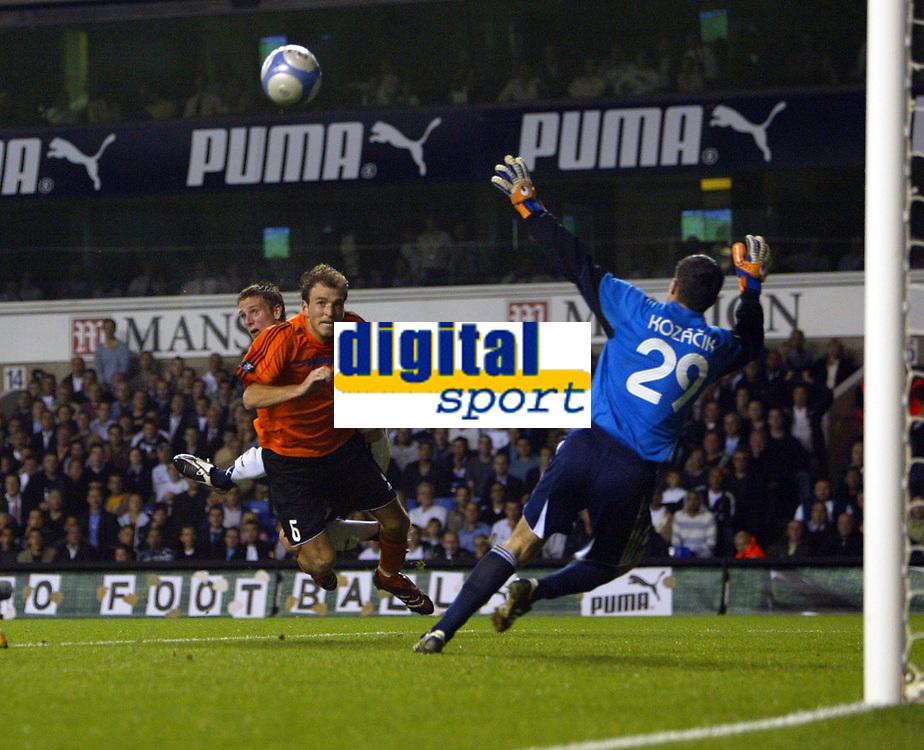 Photo: Chris Ratcliffe.<br /> Tottenham Hotspur v Slavia Prague. UEFA Cup. 28/09/2006.<br /> Calum Davenport of Spurs gets a header over Martin Latka of Slavia Prague as the keeper Matus Kozacik goes the wrong way.