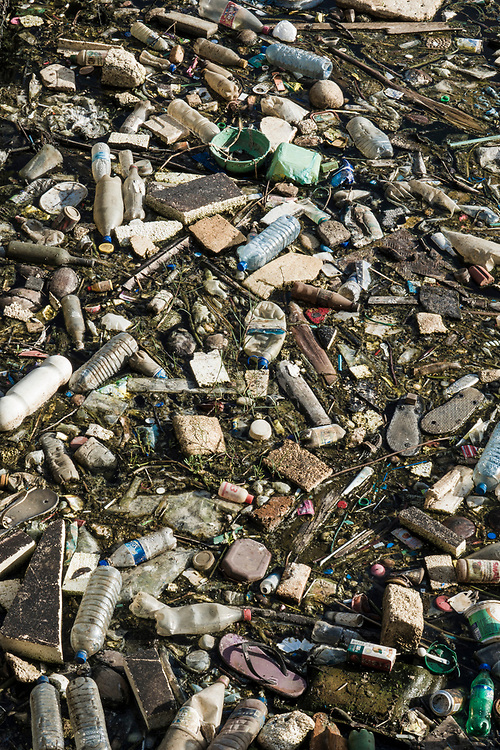 Plastic, polystyrene and other debris covers an estuary beach in Negombo, Sri Lanka