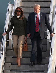 US President Donald Trump and his wife, Melania, at Prestwick airport in Ayrshire, en route for Turnberry, where they are expected to stay over the weekend.
