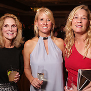 Prissy Lineberry, left, Courtney Messina, center, and Ann MacRae pose for a picture Saturday December 6, 2014 during the 9th Annual Wilmington Fur Ball at the Country Club of Landfall in Wilmington, N.C. (Jason A. Frizzelle)