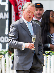 © Licensed to London News Pictures. 19/06/2015. London, UK. NIGEL FARAGE with glass of champaign in hand attends a charity cricket match, held at Burton Court, Chelsea, London in aid of former military servicemen. Photo credit: Ben Cawthra/LNP