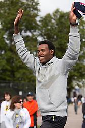 Boston Athletic Association Half Marathon; winner Lelisa Desisa on podium with Boston Red Sox cap