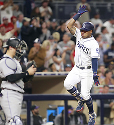 May 2, 2017 - San Diego, CA, USA - The San Diego Padres' Yangervis Solarte jumps up in celebration after he hit a two-run home run, as Colorado Rockies catcher Tony Wolters stands at home plate in the sixth inning at Petco Park in San Diego on Tuesday, May 2, 2017. (Credit Image: © Hayne Palmour Iv/TNS via ZUMA Wire)